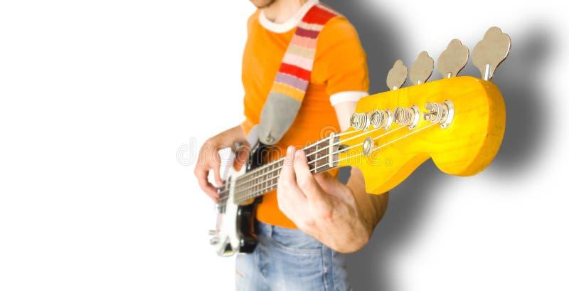 Jogador de guitarra baixa imagem de stock
