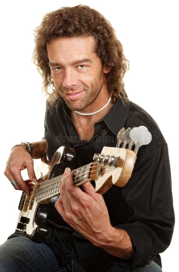 Jogador de guitarra sobre o branco fotos de stock