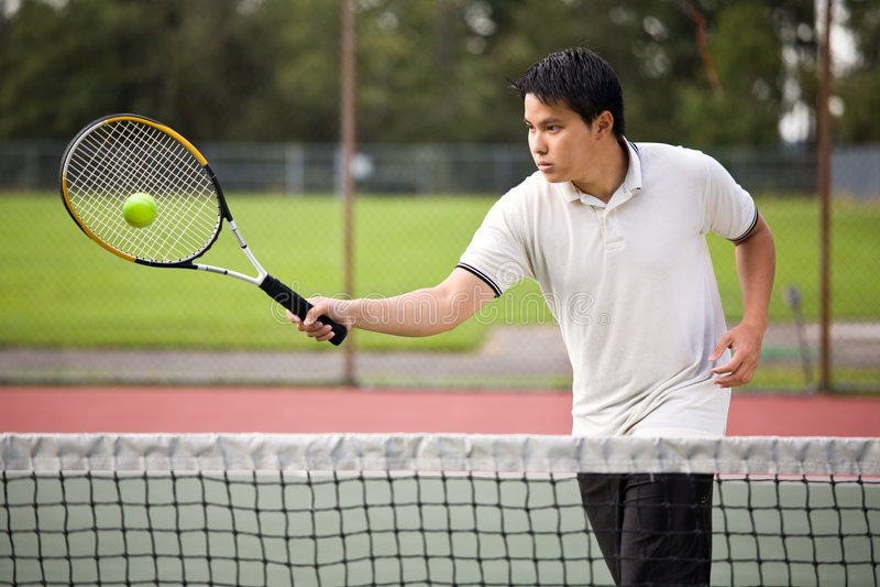 Jogador de ténis asiático foto de stock royalty free