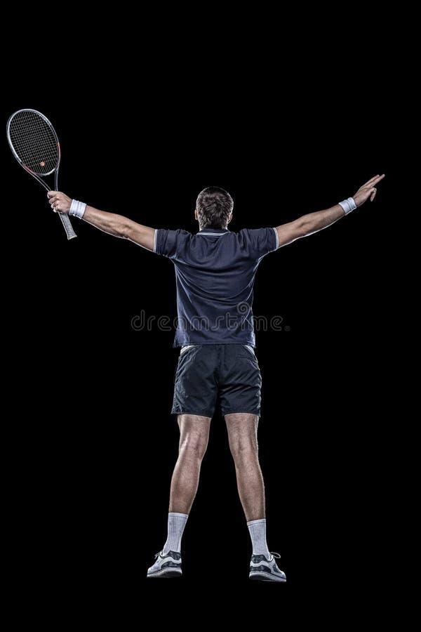 Jogador de tênis com as mãos isoladas acima no preto imagem de stock royalty free