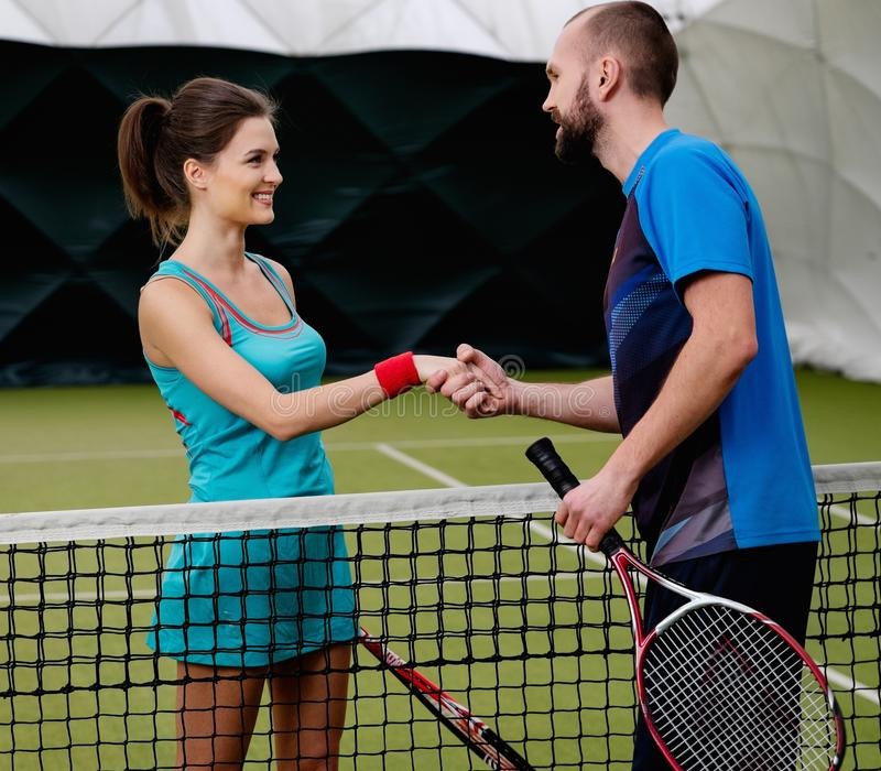 Jogador de tênis da mulher e seu treinador foto de stock royalty free