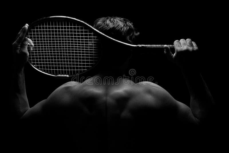 Jogador de tênis e sua raquete imagem de stock royalty free