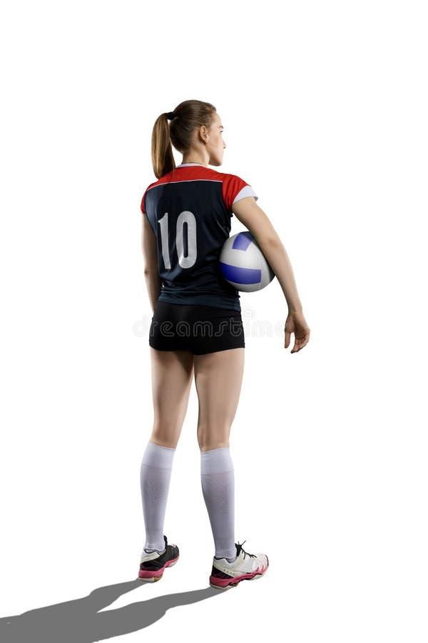Jogador de voleibol fêmea que está com bola imagens de stock royalty free
