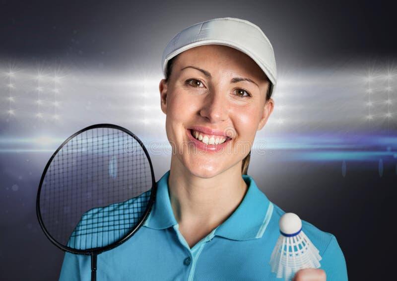 Jogador do badminton contra luzes brilhantes imagem de stock royalty free