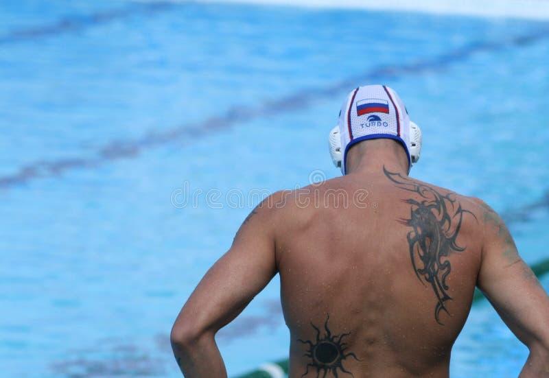Jogador do polo de água/tatuagem grande imagens de stock royalty free