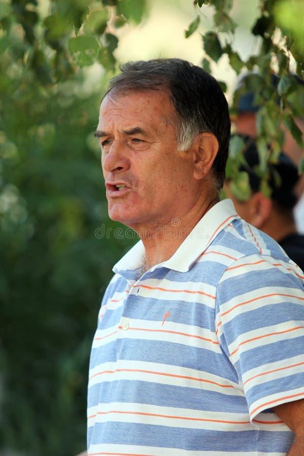 Jogador e ônibus de futebol de Dusko Bajevic imagens de stock royalty free