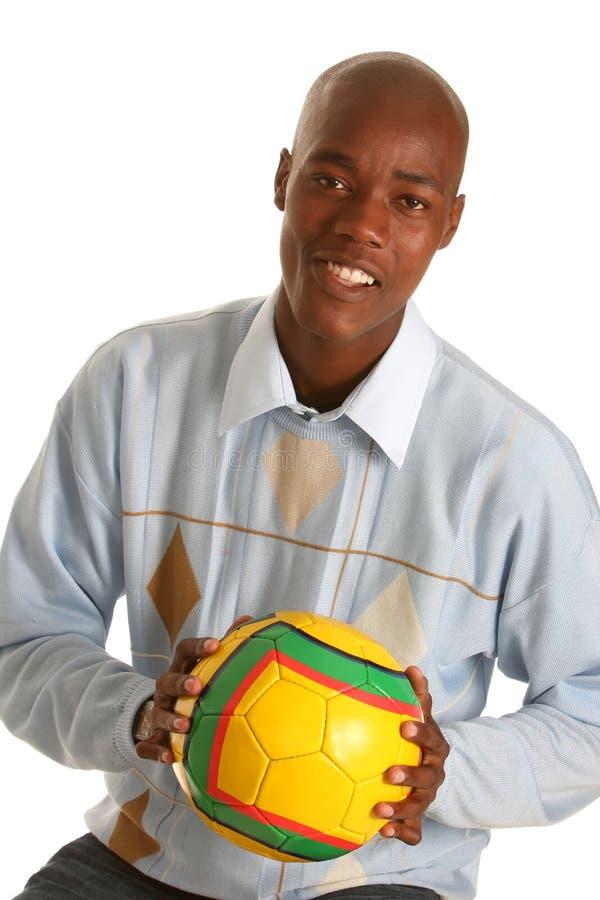 Jogador e esfera de futebol imagem de stock
