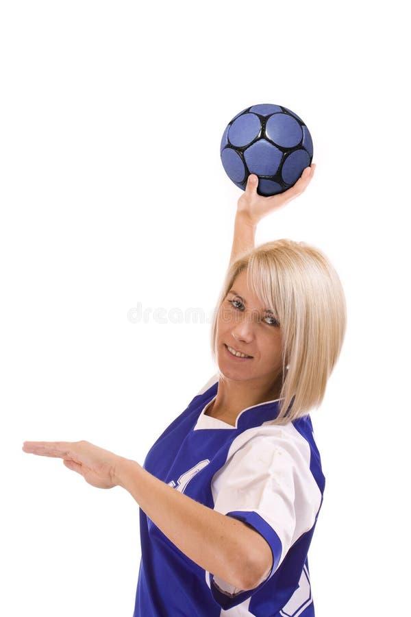 Jogador fêmea do handball fotografia de stock
