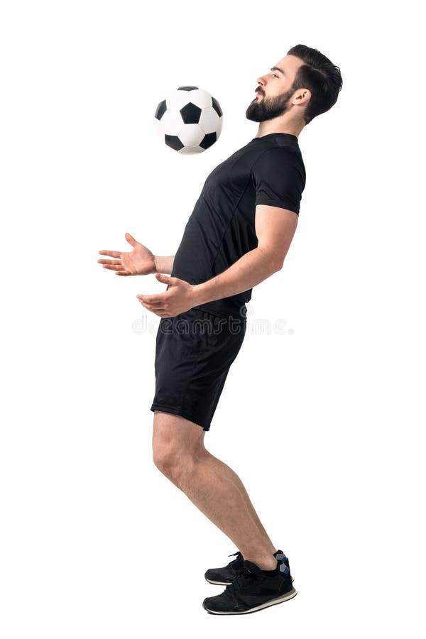 Jogador futsal do futebol que para a bola com sua caixa fotografia de stock