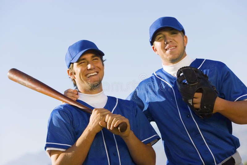 Jogadores de beisebol felizes fotografia de stock royalty free
