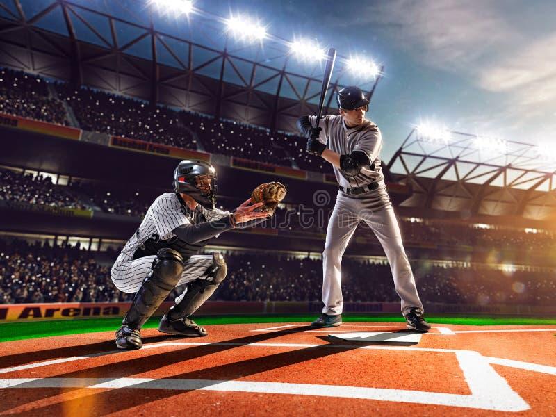 Jogadores de beisebol profissionais na arena grande fotografia de stock royalty free
