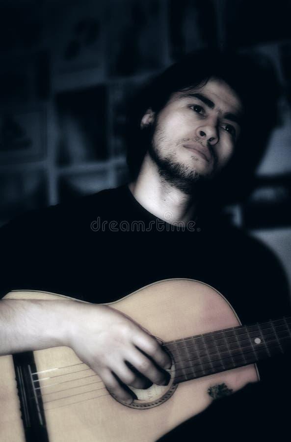 Jogando A Guitarra Imagem de Stock