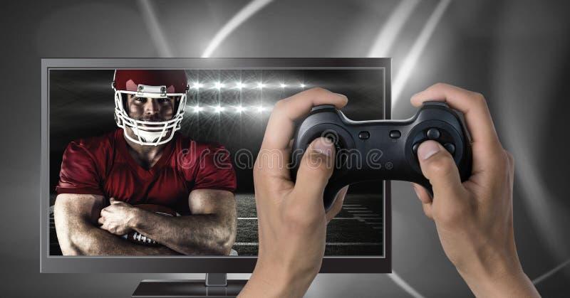 Jogando o jogo de computador do futebol americano com o controlador nas mãos fotografia de stock royalty free