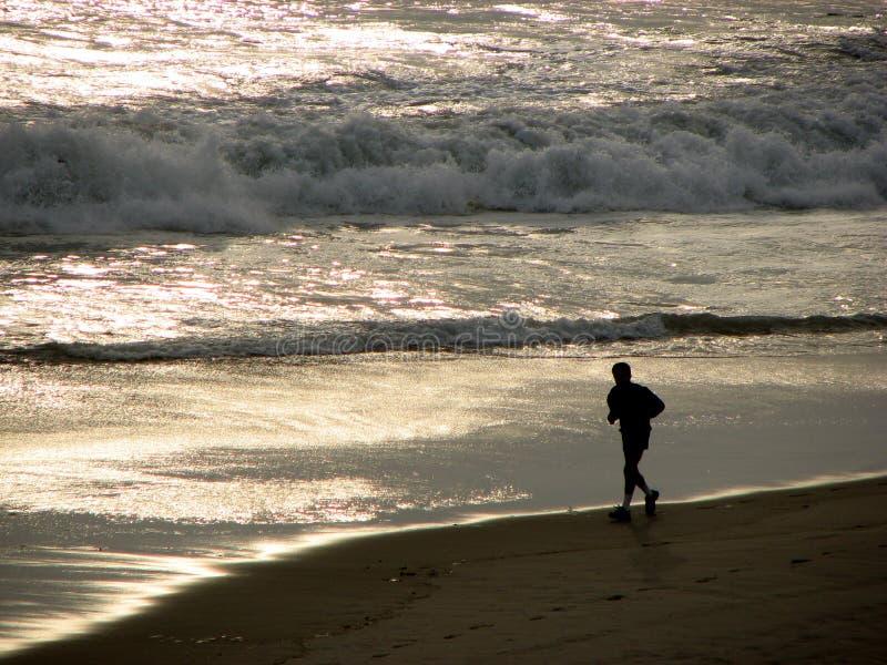 Jogger on Beach stock photos