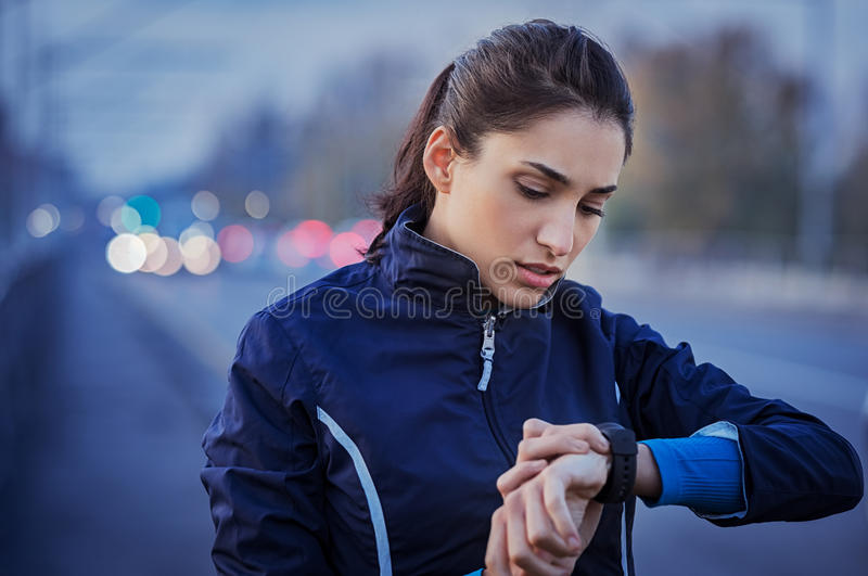 Jogger checking smart watch royalty free stock images