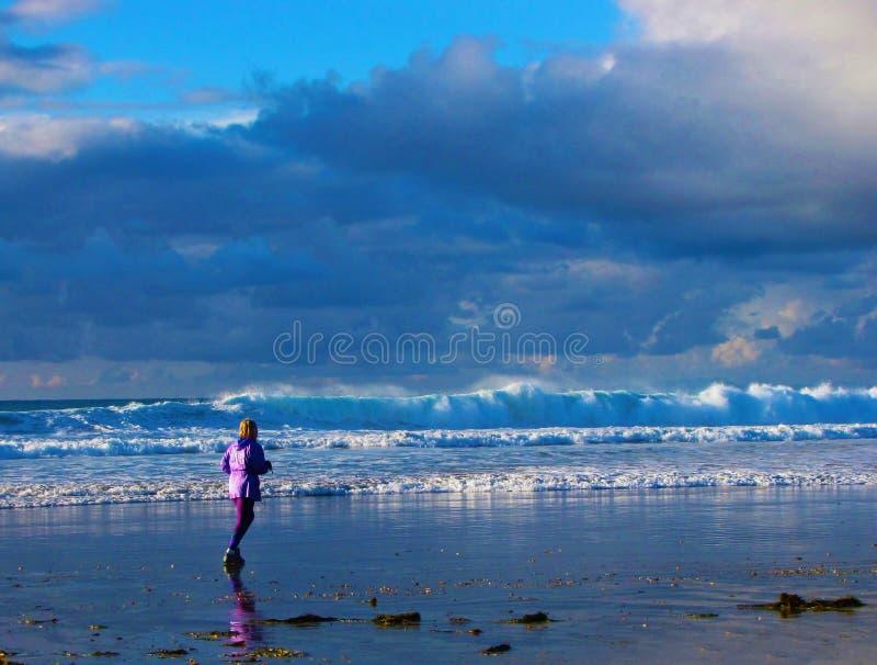 Jogger door het Overzees stock afbeeldingen