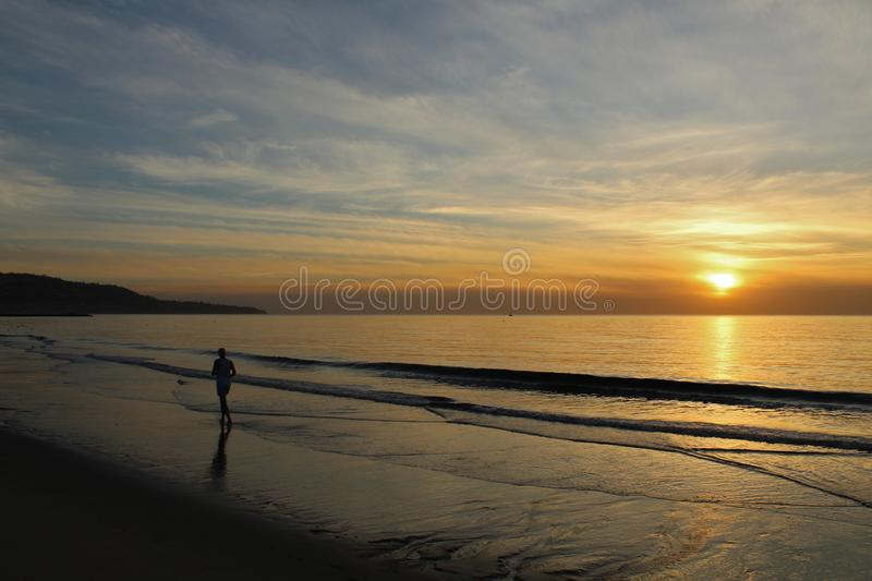 Jogger on the Shore at Sunset in Redondo Beach, Los Angeles, California stock photography