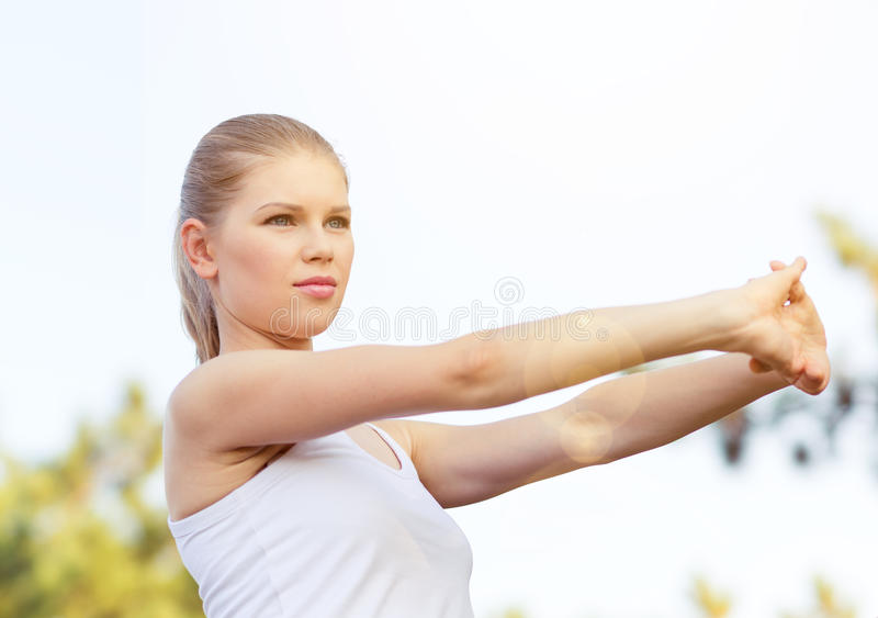 Jogger woman stretching hands