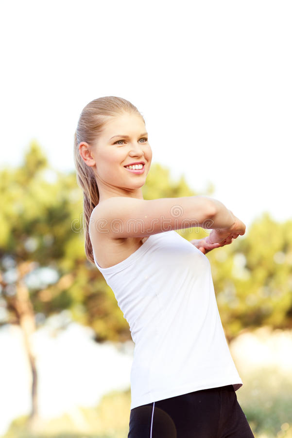 Download Jogger Woman Stretching Hands Stock Photo - Image of sporty, cross: 34591092