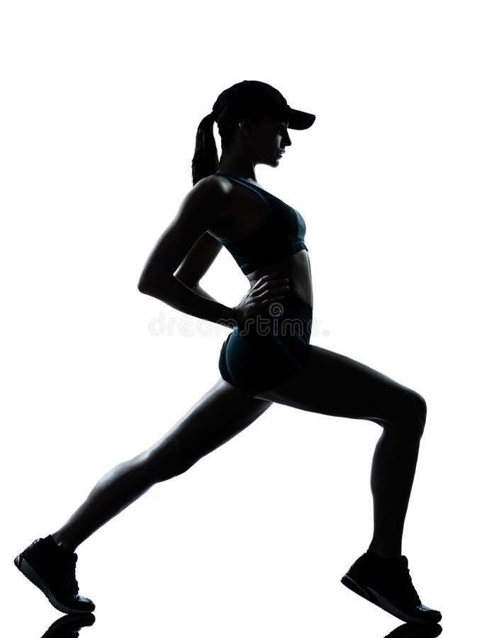 joggerlöpare som sträcker upp varm kvinna fotografering för bildbyråer