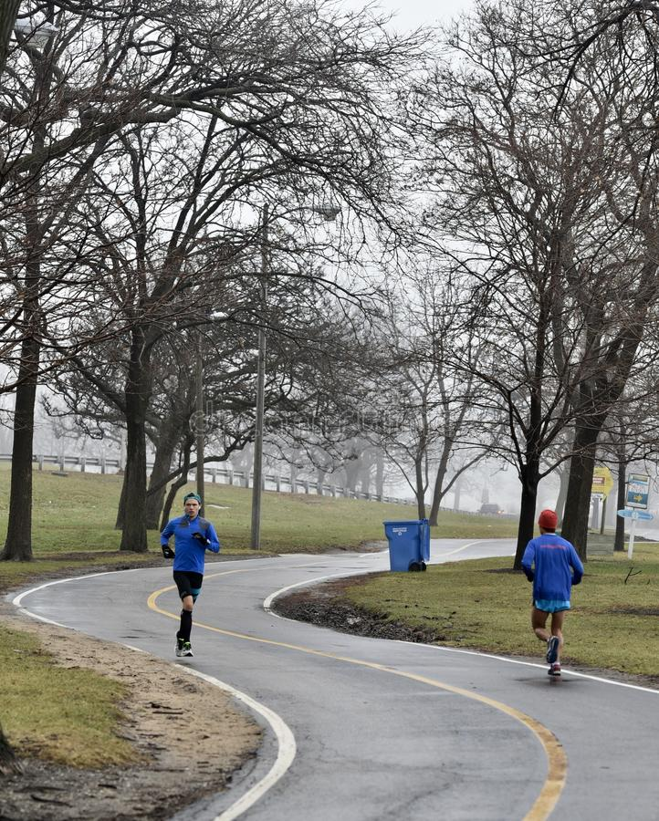 Joggers on a Foggy Path royalty free stock photos