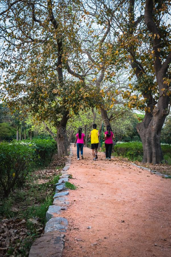 Joggers at morning in local park. Joggers taking a round at morning in local park stock image