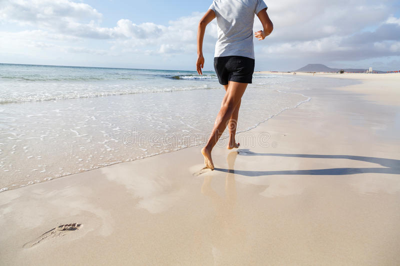 Jogging on beach stock image