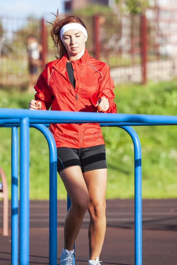 Professional Female Runner During Outdoor Training. stock images