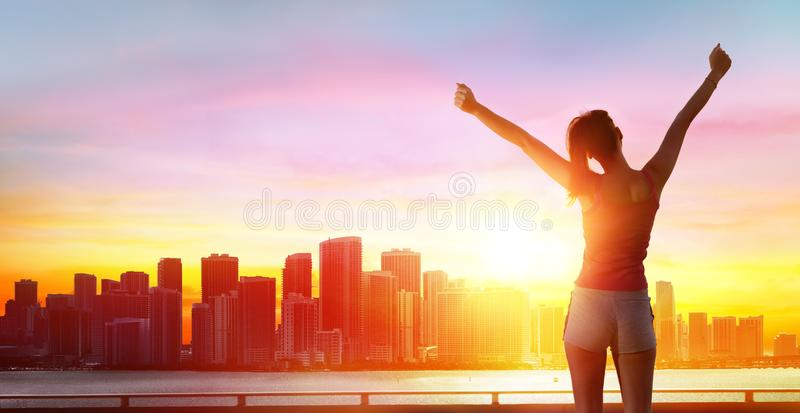 Jogging, fitness and success - girl with arms raised stock photo
