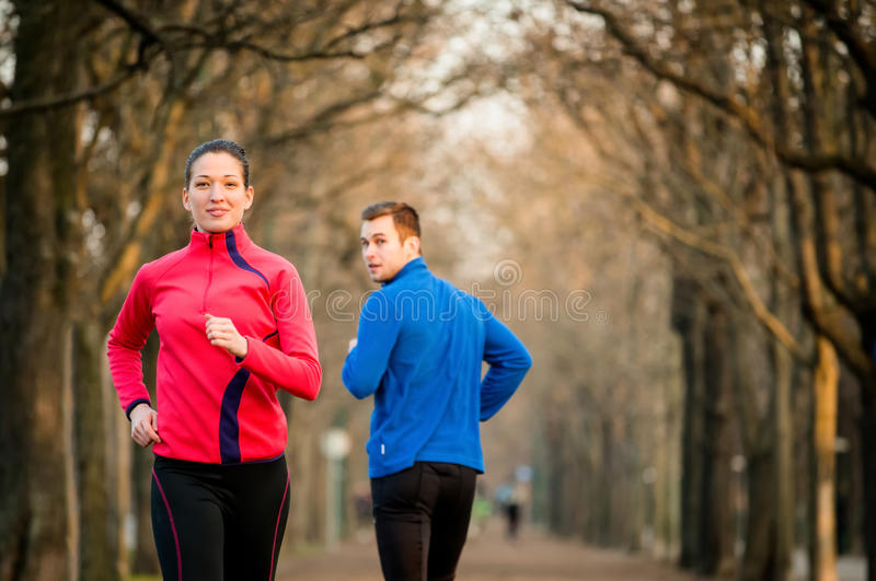Jogging in park stock photos