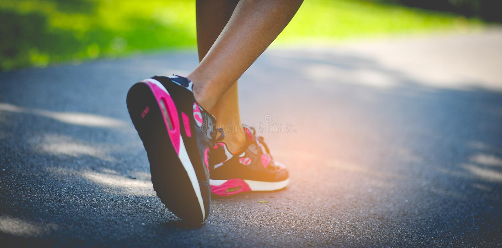 Jogging with sport shoes on holiday. Jogging with sports shoes on holiday For health and beauty. And fat reduction royalty free stock photo