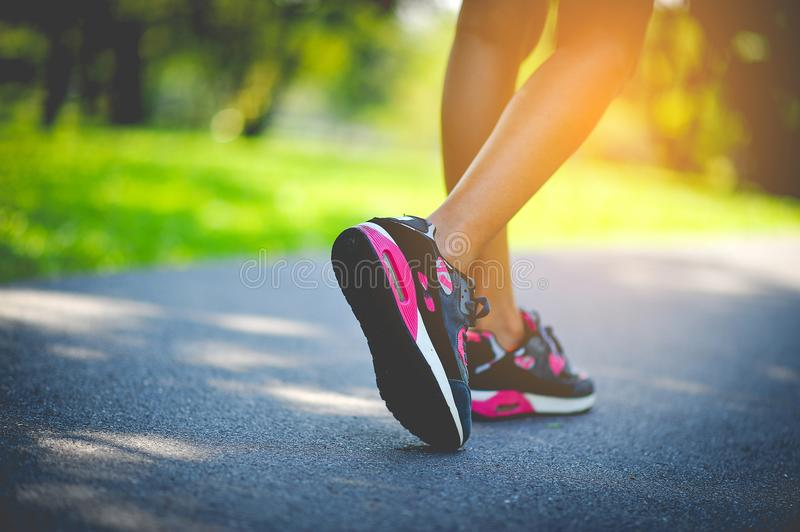 Jogging with sport shoes on holiday. Jogging with sports shoes on holiday For health and beauty. And fat reduction royalty free stock images