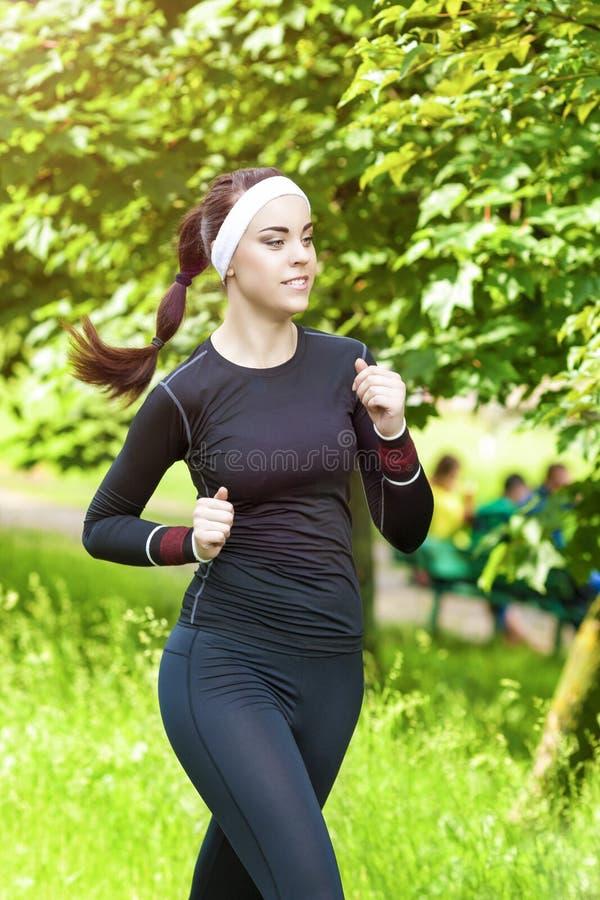 Jogging Theme: Happy Smiling Caucasian Sportswoman Having Jogging Exercises Outdoors royalty free stock photos
