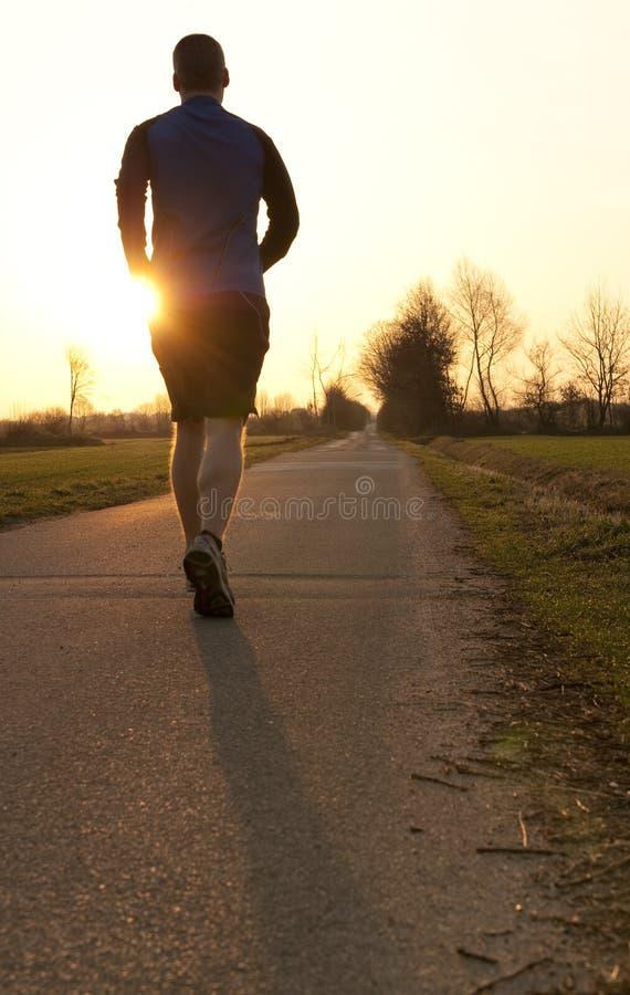 Jogging towards sunrise royalty free stock images