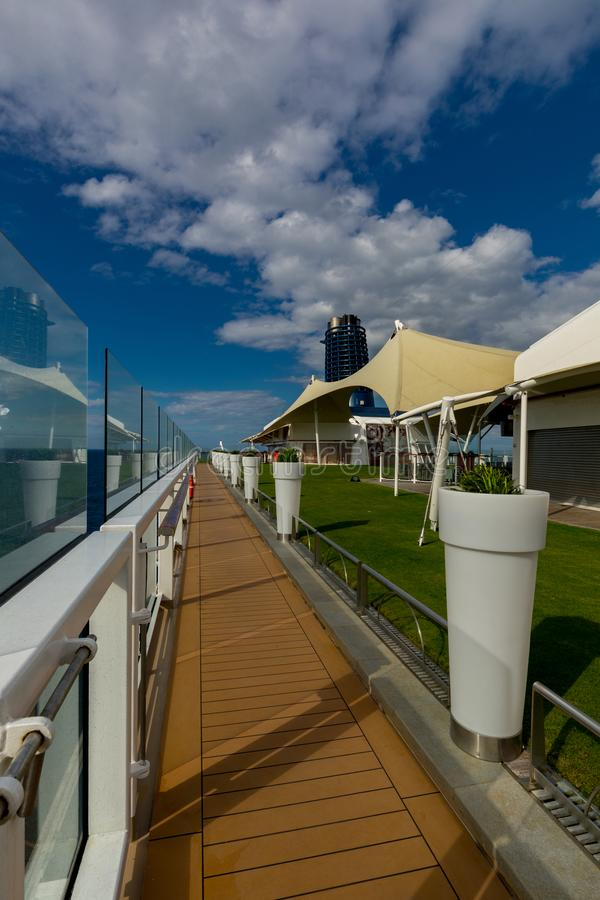 Jogging Track, White Pots, And Glass Panes Aboard Celebrity Eclipse Cruise royalty free stock photo