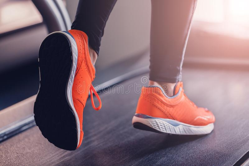 Jogging in a tripod hall a treadmill sports shoes stock image