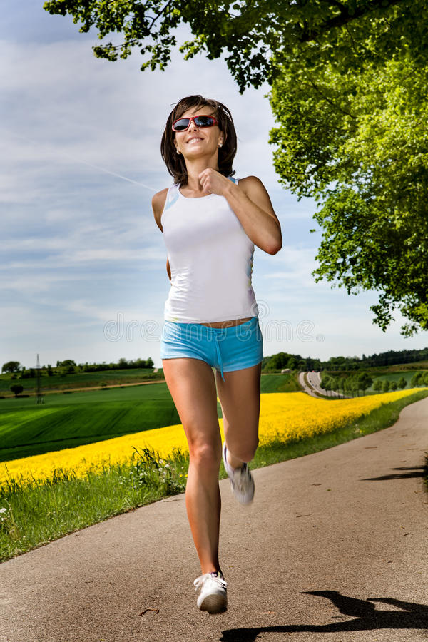 Download Jogging woman stock image. Image of people, female, action - 27596495