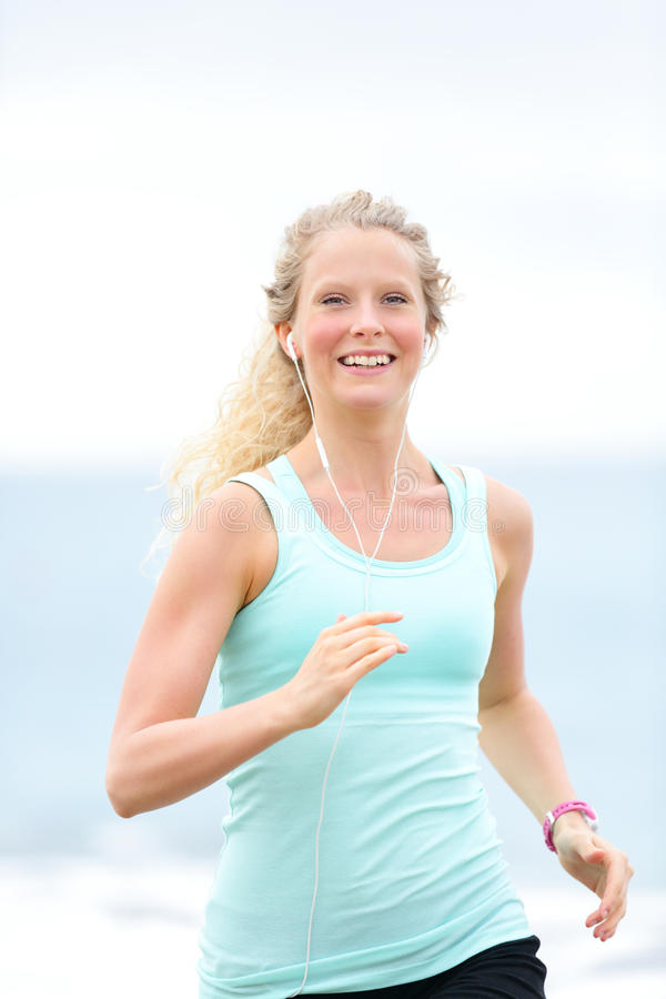 Download Jogging Woman Running Woman Outside On Beach Stock Photo - Image of fitness, adult: 39510368