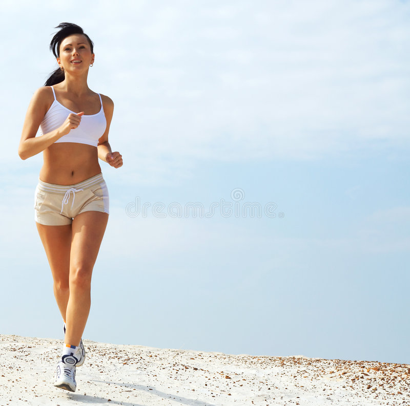 Joggingwoman dans le blanc   photos stock