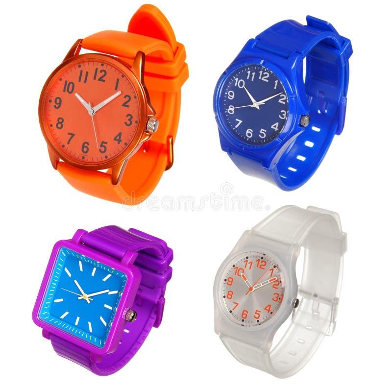 Jogo colorido de relógios de pulso plásticos imagem de stock