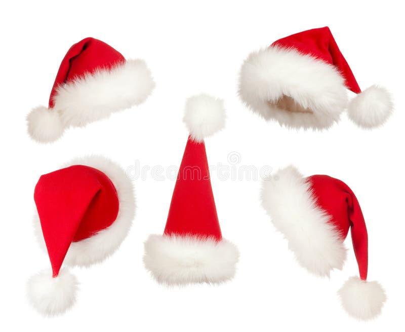 Jogo de chapéus de Santa do Natal imagens de stock royalty free