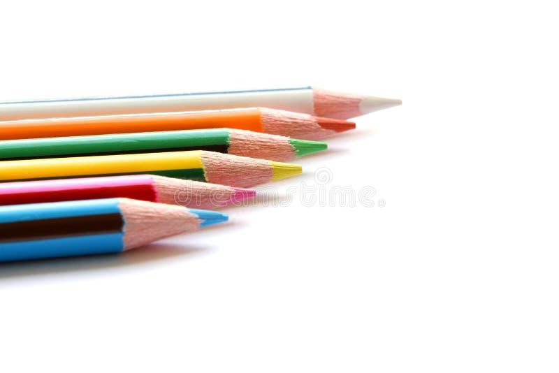 Jogo de lápis da cor no branco fotos de stock royalty free
