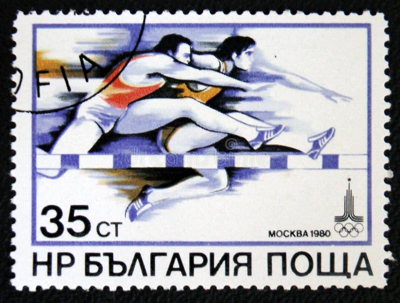 Jogo 1980 de Olimpic em Moscou Corrida de obstáculos das mostras Cerca de 1980 imagem de stock royalty free