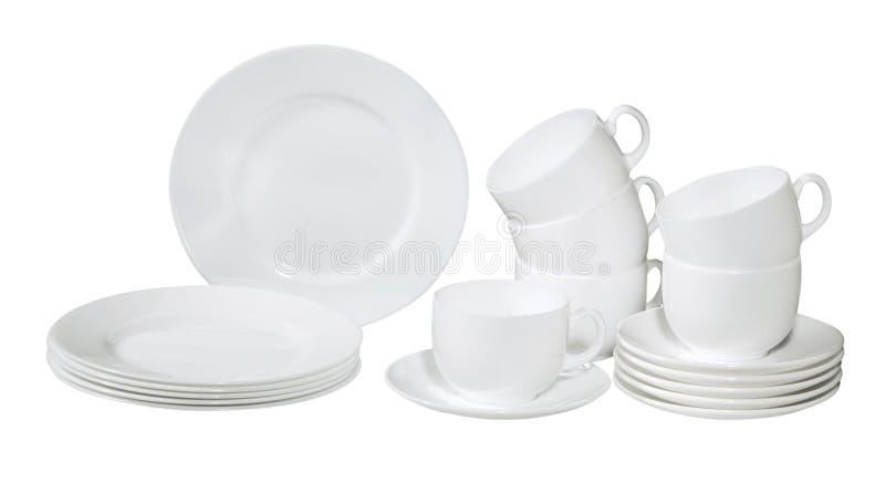 Jogo de placas e de pratos lavados frescos imagem de stock royalty free
