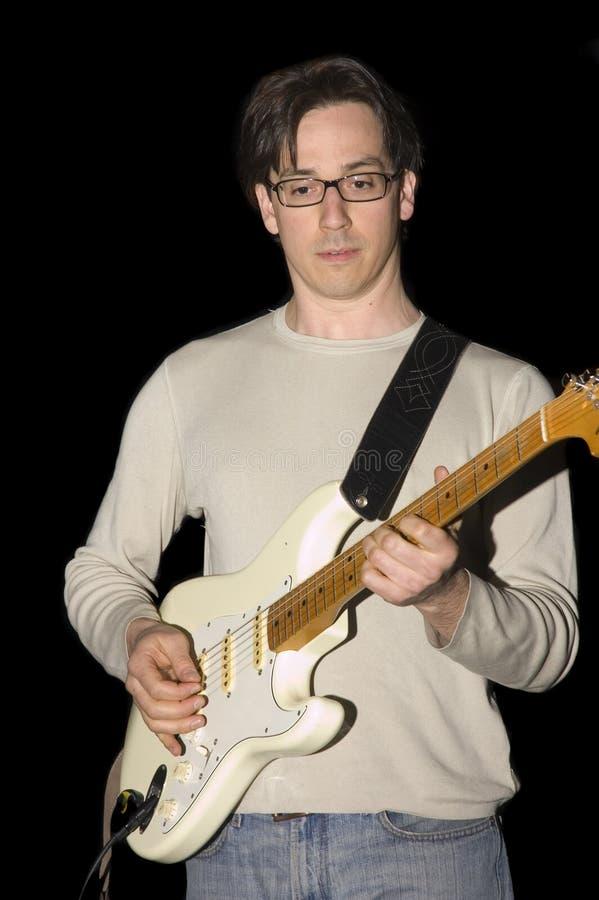 Jogo do guitarrista de ligação foto de stock royalty free
