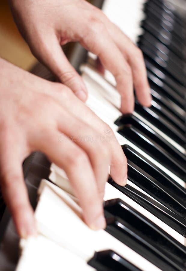 Jogo do piano fotos de stock