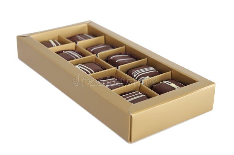 Jogo dos chocolates em uma caixa no fundo branco imagens de stock