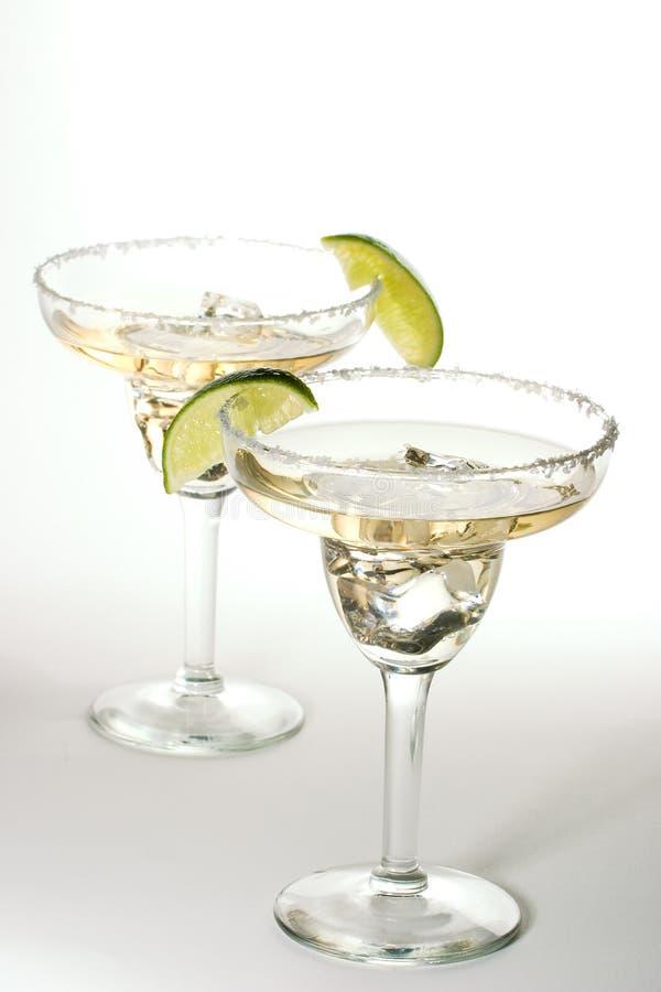 Jogo dos cocktail com gelo em vidros de Martini fotografia de stock royalty free