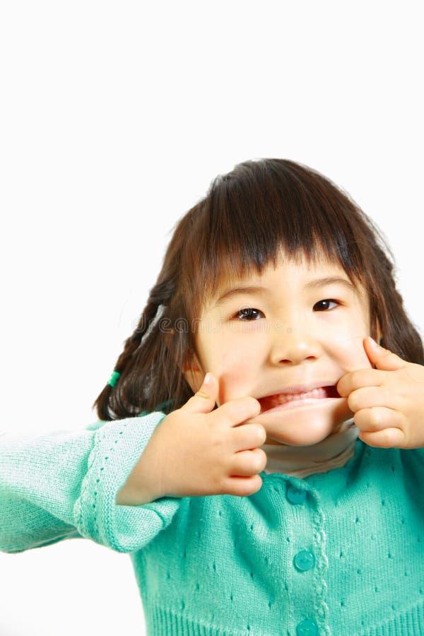 Jogo japonês pequeno da menina o tolo imagens de stock royalty free