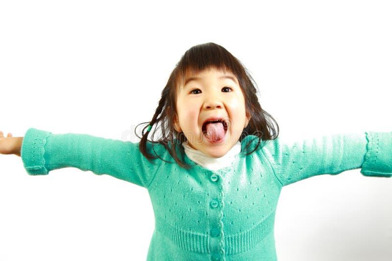 Jogo japonês pequeno da menina o tolo foto de stock